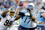 Tennessee Titans quarterback Ryan Tannehill (17) is sacked by Los Angeles Chargers defensive end Joey Bosa and defensive tackle Jerry Tillery (99) in the second half of an NFL football game Sunday, Oct. 20, 2019, in Nashville, Tenn. (AP Photo/James Kenney)