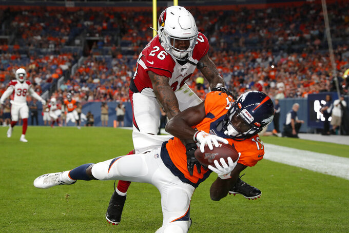 Denver Broncos wide receiver Fred Brown (19) makes a touchdown catch as Arizona Cardinals cornerback Brandon Williams (26) defends during the first half of an NFL preseason football game, Thursday, Aug. 29, 2019, in Denver. (AP Photo/David Zalubowski)