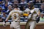 San Diego Padres' Jake Cronenworth, left, celebrates with Fernando Tatis Jr. after they scored on a home run by Cronenworth during the seventh inning of a baseball game against the New York Mets on Friday, June 11, 2021, in New York. (AP Photo/Frank Franklin II)