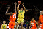 Notre Dame's D.J. Harvey (5) goes up for a shot between Syracuse's Bourama Sidibe (34) and Tyus Battle (25) during the second half of an NCAA college basketball game Saturday, Jan. 5, 2019, in South Bend, Ind. Syracuse won 72-62. (AP Photo/Robert Franklin)