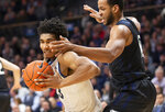 Villanova forward Jermaine Samuels (23) moves around Butler forward Bryce Nze (10) during the first half of an NCAA college basketball game, Tuesday, Jan. 21, 2020, in Villanova, Pa. (AP Photo/Laurence Kesterson)