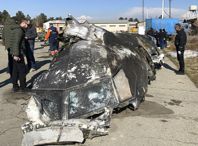 This undated photo provided by the Ukrainian Presidential Press Office, shows the wreckage of the Ukraine International Airlines Boeing 737-800 at the scene of the crash in Shahedshahr, southwest of the capital Tehran, Iran. Iran has acknowledged that its armed forces