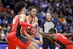 Mississippi forward KJ Buffen, center, is stopped by Georgia defenders Toumani Camara (10) and Jordan Harris (2) in the second half of an NCAA college basketball game in the Southeastern Conference Tournament Wednesday, March 11, 2020, in Nashville, Tenn. Georgia won 81-63. (AP Photo/Mark Humphrey)