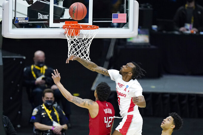 Houston's DeJon Jarreau (3) blocks a shot by Rutgers' Jacob Young (42) during the first half of a college basketball game in the second round of the NCAA tournament at Lucas Oil Stadium in Indianapolis Sunday, March 21, 2021. (AP Photo/Mark Humphrey)