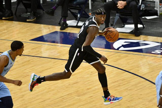 Brooklyn Nets guard Caris LeVert (22) brings the ball upcourt in the second half of an NBA basketball game against the Memphis Grizzlies, Friday, Jan. 8, 2021, in Memphis, Tenn. (AP Photo/Brandon Dill)