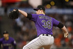 Colorado Rockies pitcher Tim Melville works against the San Francisco Giants during the first inning of a baseball game Wednesday, Sept. 25, 2019, in San Francisco. (AP Photo/Ben Margot)