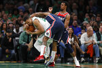 Boston Celtics' Grant Williams tries to take the ball from Washington Wizards' Bradley Beal during the fourth quarter of an NBA basketball game Wednesday, Nov. 13, 2019, in Boston. (AP Photo/Winslow Townson)