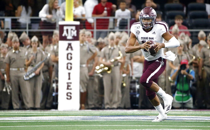 Texas A&M quarterback Kellen Mond (11) carries the ball against Arkansas during the first half of an NCAA college football game Saturday, Sept. 28, 2019, in Arlington, Texas. (AP Photo/Ron Jenkins)