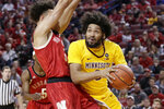 Minnesota's Jordan Murphy, right, drives to the basket around Nebraska's Isaiah Roby (15) during the first half of an NCAA college basketball game in Lincoln, Neb., Wednesday, Feb. 13, 2019. (AP Photo/Nati Harnik)