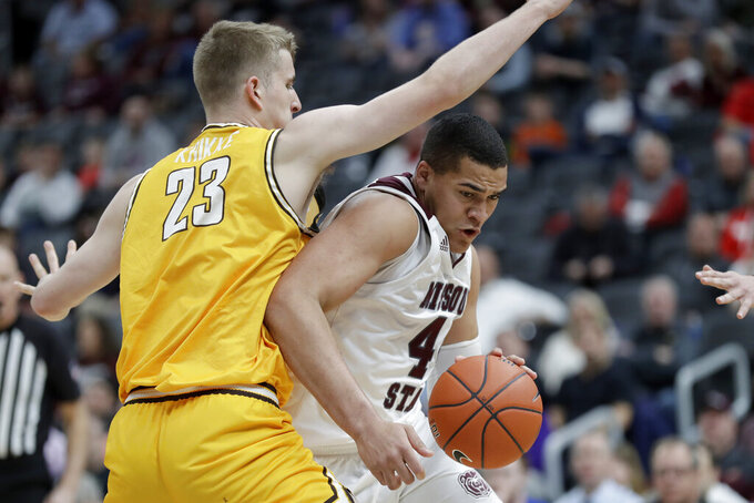 Missouri State's Gaige Prim, right, heads to the basket past Valparaiso's Ben Krikke (23) during the second half of an NCAA college basketball game in the semifinal round of the Missouri Valley Conference men's tournament Saturday, March 7, 2020, in St. Louis. (AP Photo/Jeff Roberson)
