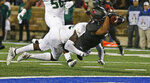 Tulsa running back Shamari Brooks dives into the end zone for a touchdown as he is tackled by South Florida defensive back Mekhi LaPointe, left, during the second half of an NCAA college football game in Tulsa, Okla., Friday, Oct. 12, 2018. (AP Photo/Sue Ogrocki)