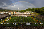 A rainbow appears beyond Kidd Brewer Stadium as Appalachian State takes on Elon during an NCAA college football game in Boone, N.C., Saturday, Sept. 18, 2021. (Kenneth Ferriera/News & Record via AP)
