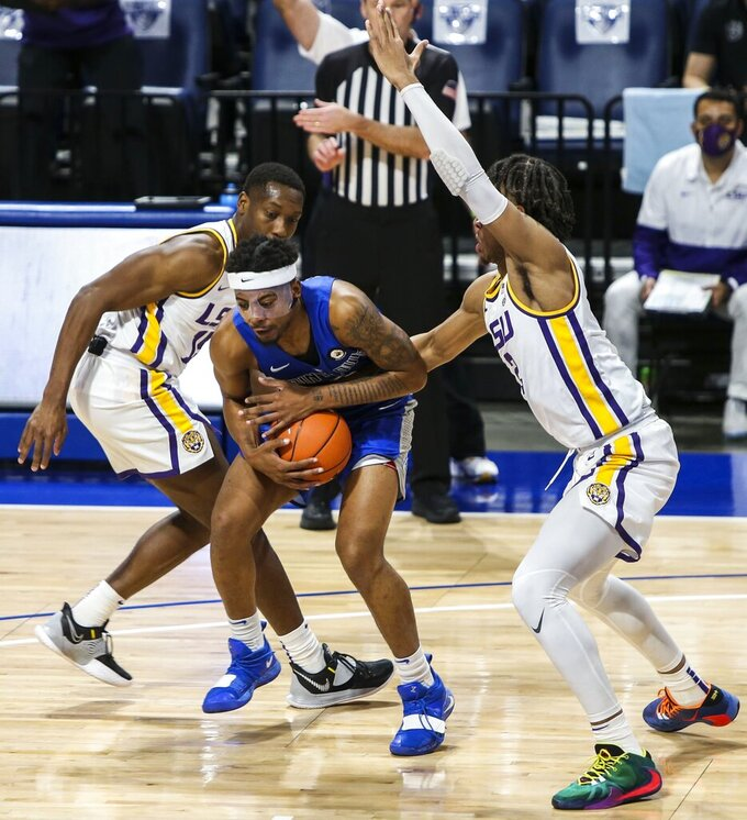 Saint Louis guard Jordan Goodwin (0) tries to keep control of the ball as Louisiana State guard Aundre Hyatt (15), left, and forward Trendon Watford (2) try to grab the ball during the first half of an NCAA college basketball game in St. Louis, Mo., Saturday, Nov. 28, 2020.  (Cheyenne Boone/St. Louis Post-Dispatch via AP)