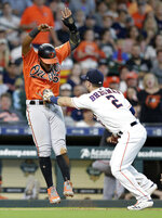 Baltimore Orioles' Hanser Alberto, left, is tagged on a pickle play by Houston Astros third baseman Alex Bregman (2) during the eighth inning of a baseball game Saturday, June 8, 2019, in Houston. (AP Photo/Michael Wyke)