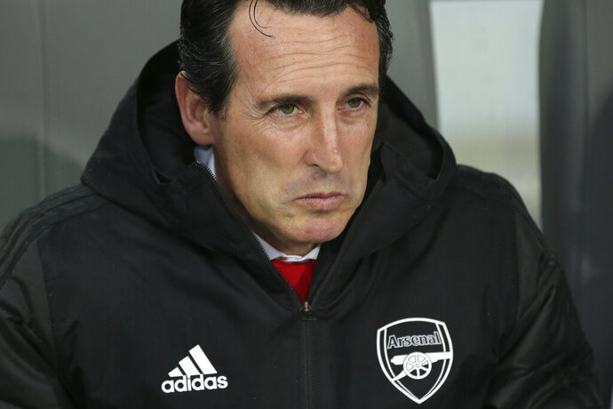 FILE - In this file photo dated Wednesday, Nov. 6, 2019, Arsenal's head coach Unai Emery during the Europa League soccer match against Vitoria at the D. Afonso Henriques stadium in Guimaraes, Portugal.  Emery was fired by Arsenal on Friday, Nov. 29, 2019, 18 months after succeeding Arsene Wenger as manager of the English Premier League club. (AP Photo/Luis Vieira, FILE)