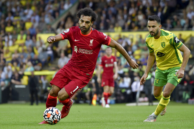 FILE - In this Aug. 14, 2021 file photo, Liverpool's Mohamed Salah runs with the ball during the English Premier League soccer match against Norwich City at Carrow Road Stadium in Norwich, England. Egypt's soccer association on Saturday, Sept. 4, says Salah has arrived in Gabon to join the Pharaohs for their World Cup qualifying match.  (AP photo/Rui Vieira, File)
