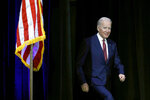 Democratic presidential candidate, former U.S. Vice President Joe Biden walks onstage to participate in a candidate forum on infrastructure at the University of Nevada, Las Vegas, Sunday, Feb. 16, 2020, in Las Vegas. (AP Photo/Patrick Semansky)