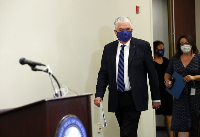Nevada Governor Steve Sisolak arrives for a news conference at the Grant Sawyer State Building in Las Vegas, Tuesday, Sept. 29, 2020. The governor provided updates on Nevada's COVID-19 response efforts and adjustments to current capacity limits on gatherings. (Steve Marcus/Las Vegas Sun via AP, Pool)