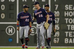 Minnesota Twins outfielders Eddie Rosario (20), Max Kepler (26) and Byron Buxton (25) celebrate after the Twins defeated the Boston Red Sox 2-1 in a baseball game at Fenway Park, Thursday, Sept. 5, 2019, in Boston. (AP Photo/Elise Amendola)
