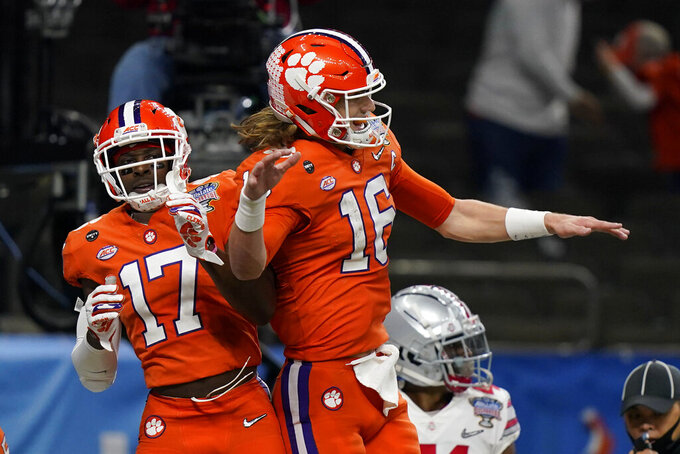 Clemson wide receiver Cornell Powell, left, celebrates his touchdown with quarterback Trevor Lawrence during the second half of the Sugar Bowl NCAA college football game against Ohio State Friday, Jan. 1, 2021, in New Orleans. (AP Photo/Gerald Herbert)