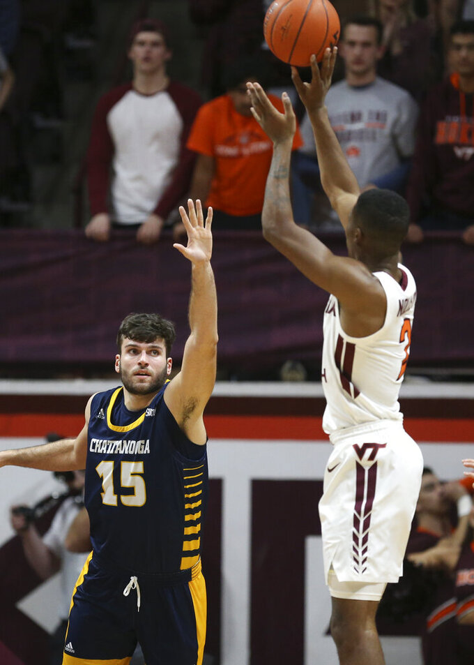 Virginia Tech's Landers Nolley II shoots over Chattanooga's Ramon Vila (15) in the first half of an NCAA college basketball game, Wednesday, Dec. 11, 2019, in Blacksburg, Va. (Matt Gentry/The Roanoke Times via AP)