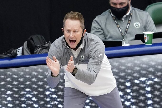 Colorado State head coach Niko Medved applauds his teams effort in the second half of an NCAA college basketball game against North Carolina State in the quarterfinals of the NIT, Thursday, March 25, 2021, in Frisco, Texas. (AP Photo/Tony Gutierrez)