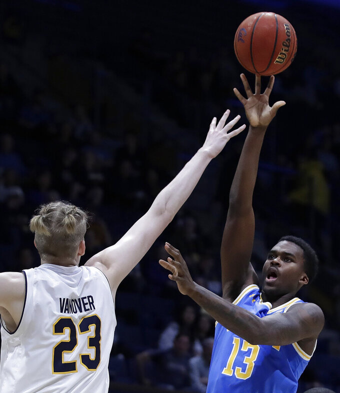 UCLA's Kris Wilkes, right, is defended by California's Connor Vanover (23) during the first half of an NCAA college basketball game Wednesday, Feb. 13, 2019, in Berkeley, Calif. (AP Photo/Ben Margot)