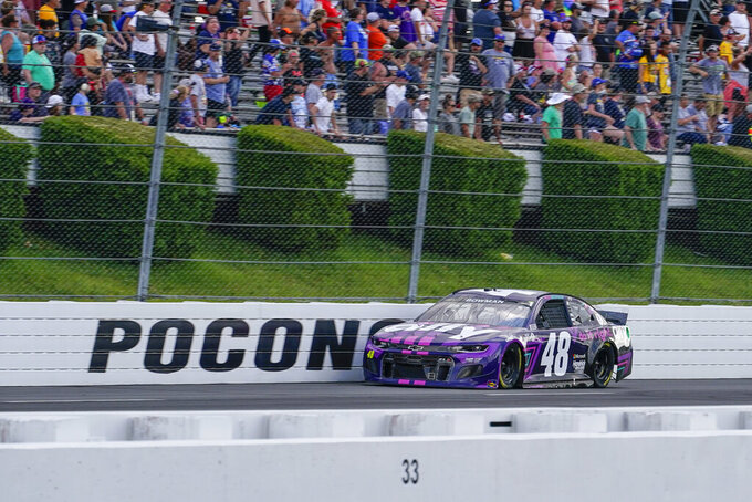 Alex Bowman (48) motors down the front straight near the end of a NASCAR Cup Series auto race at Pocono Raceway, Saturday, June 26, 2021, in Long Pond, Pa. Bowman passed Kyle Larson on the last lap to win. (AP Photo/Matt Slocum)
