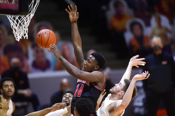 Georgia's Tye Fagan (14) shoots while guarded by Tennessee's John Fulkerson, right, during an NCAA college basketball game Wednesday, Feb. 10, 2021, in Knoxville, Tenn. (Caitie McKekin/Knoxville News Sentinel via AP, Pool)