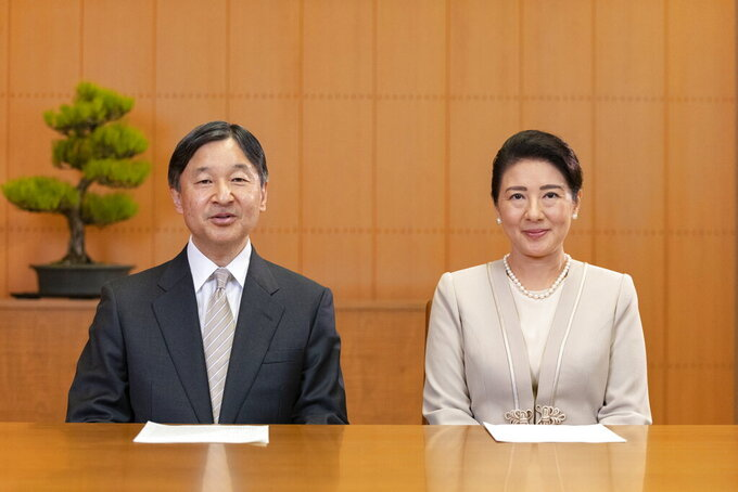 In this photo provided by the Imperial Household Agency of Japan, Japan's Emperor Naruhito and his wife Empress Masako, speak for their New Year video message at their Akasaka Estate residence in Tokyo, on Dec. 28, 2020. (The Imperial Household Agency of Japan via AP)