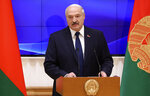 Belarusian President Alexander Lukashenko speaks to former and new-elected members of the National Assembly of Belarus during their meeting in Minsk, Belarus, Thursday, Dec. 5, 2019. Lukashenko told Belarus' parliament on Thursday that he wouldn't sign any documents that could harm the ex-Soviet republic's interests and added that any union with Russia would be formed on equal terms. (Nikolai Petrov/BelTA Pool Photo via AP)