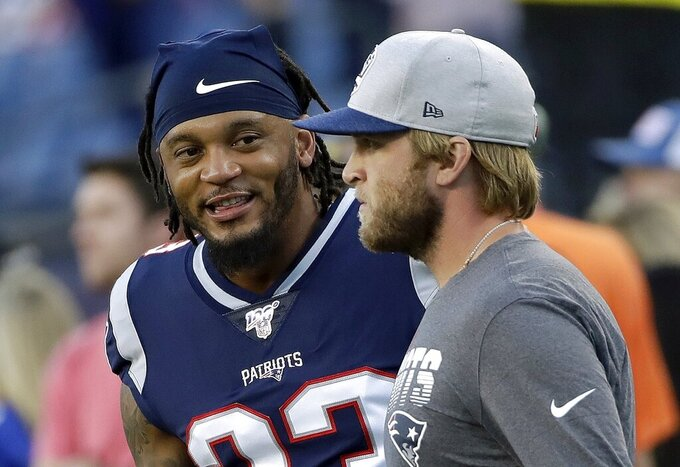 New England Patriots strong safety Patrick Chung, left, warms up beside Patriots safeties coach Steve Belichick, right, before an NFL preseason football game against the New York Giants, Thursday, Aug. 29, 2019, in Foxborough, Mass. (AP Photo/Elise Amendola)