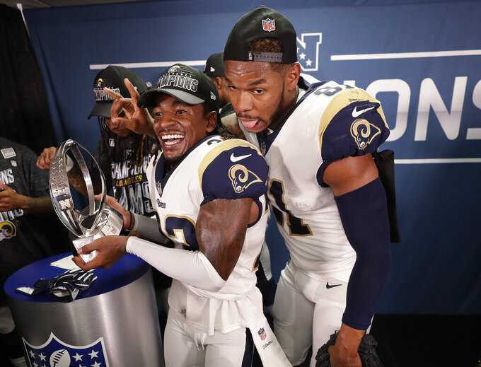 Los Angeles Rams defensive back Nickell Robey-Coleman (23) and Los Angeles Rams tight end Gerald Everett (81) celebrate in the locker room after overtime of the NFL football NFC championship game, against the New Orleans Saints, Sunday, Jan. 20, 2019, in New Orleans. The Rams won 26-23. (AP Photo/David J. Phillip)