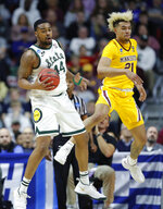 Michigan State forward Nick Ward grabs a rebound in front of Minnesota forward Jarvis Omersa, right, during a second round men's college basketball game in the NCAA Tournament, Saturday, March 23, 2019, in Des Moines, Iowa. (AP Photo/Charlie Neibergall)