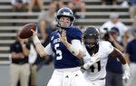Rice quarterback Wiley Green (5) passes the ball as Wake Forest linebacker JaCorey Johns (41) closes in during the first half of an NCAA college football game Friday, Sept. 6, 2019, in Houston. Green was hurt during a tackle on a keeper play just short of the goal line and was carted off the field. (AP Photo/Michael Wyke)