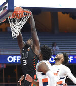 Miami center Nysier Brooks (3) dunks over Syracuse forwards Alan Griffin and Quincy Guerrier (1) during an NCAA college basketball game Tuesday, Jan. 19, 2021 in Syracuse, N.Y. (Dennis Nett/The Post-Standard via AP)