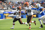 Cleveland Browns running back Kareem Hunt (27) scores a touchdown during the second half of an NFL football game against the Los Angeles Chargers Sunday, Oct. 10, 2021, in Inglewood, Calif. (AP Photo/Kevork Djansezian)