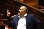 Leader of the United Arab List Mansour Abbas attends a Knesset session in Jerusalem Sunday, June 13, 2021. Bennett is expected later Sunday to be sworn in as the country's new prime minister, ending Prime Minister Benjamin Netanyahu's 12-year rule. (AP Photo/Ariel Schalit)