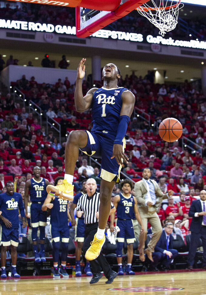Pittsburgh's Xavier Johnson (1) shouts as he finishes a dunk during the second half of an NCAA college basketball game against North Carolina State in Raleigh, N.C., Saturday, Jan. 12, 2019. (AP Photo/Ben McKeown)