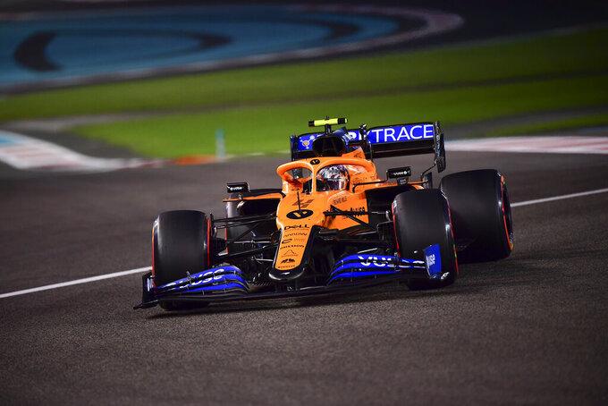 Mclaren driver Lando Norris of Britain in action during the qualifying at the Formula One Abu Dhabi Grand Prix in Abu Dhabi, United Arab Emirates, Saturday, Dec. 11, 2020 (Giuseppe Cacace, Pool via AP)