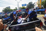 """FILE - In this Sunday, Oct. 14, 2018 file photo, anti-government protesters are arrested and taken away by police as the security forces disrupt their """"United for Freedom"""" march in Managua, Nicaragua. Anti-government protests calling for President Daniel Ortega's resignation started in April, triggered by a since-rescinded government plan to cut social security pensions. Ortega said opponents will have to wait until his term ends in 2021. (AP Photo/Alfredo Zuniga, File)"""