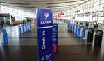 The check-in area for Latam airplanes is empty at the Arturo Merino Benitez airport in Santiago, Chile, Tuesday, May 26, 2020. South America's biggest carrier is seeking U.S. bankruptcy protection as it grapples with a sharp downturn in air travel sparked by the coronavirus pandemic. (AP Photo/Esteban Felix)