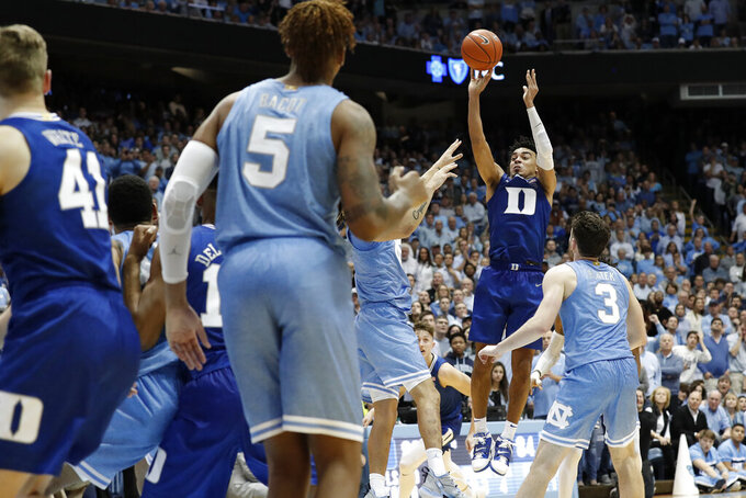 Duke guard Tre Jones shoots against North Carolina during the second of an NCAA college basketball game in Chapel Hill, N.C., Saturday, Feb. 8, 2020. Jones scored to force the game into overtime. (AP Photo/Gerry Broome)