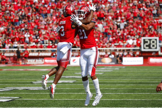 Utah wide receiver Demari Simpkins (3) celebrates with teammate Solomon Enis (21) after scoring against Northern Illinois in the first half of an NCAA college football game Saturday, Sept. 9, 2019, Salt Lake City. (AP Photo/Rick Bowmer)