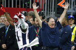 FILE - In this Feb. 3, 2019, file photo, New England Patriots' Duron Harmon (21) and head coach Bill Belichick celebrate after the NFL Super Bowl 53 football game against the Los Angeles Rams in Atlanta. Among Pro Football Hall of Fame coach Don Shula's many achievements, his 347 victories with the Baltimore Colts and Miami Dolphins stood out. But now Shula's gone, and the title of winningest coach is in jeopardy. Bill Belichick easily leads all active coaches with 304 victories in 25 seasons and is still going strong with the Patriots.   (AP Photo/Patrick Semansky, File)