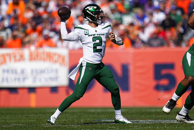 New York Jets quarterback Zach Wilson (2) throws during the first half of an NFL football game against the Denver Broncos, Sunday, Sept. 26, 2021, in Denver. (AP Photo/Jack Dempsey)