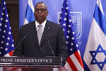 U.S. Defense Secretary Lloyd Austin and Israeli Prime Minister Benjamin Netanyahu  give statements after their meeting, at the prime minister's office, in Jerusalem, Monday, April 12, 2021. (Menahem Kahana/Pool via AP)