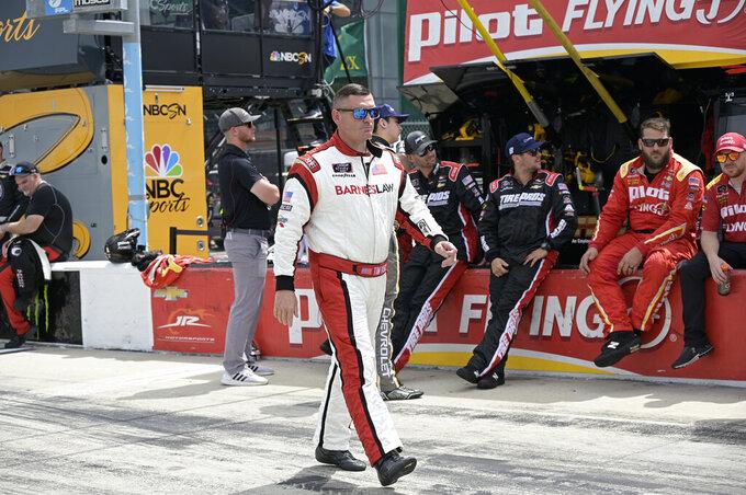 Driver Tim Viens walks to his vehicle on pit road before a NASCAR Xfinity Series auto race at Daytona International Speedway, Saturday, Aug. 28, 2021, in Daytona Beach, Fla. (AP Photo/Phelan M. Ebenhack)