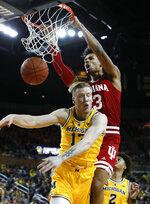Indiana forward Justin Smith (3) dunks on Michigan forward Ignas Brazdeikis (13) in the first half of an NCAA college basketball game in Ann Arbor, Mich., Sunday, Jan. 6, 2019. (AP Photo/Paul Sancya)