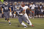 Nevada running back Devonte Lee (2) cuts back against New Mexico in the first half of an NCAA college football game in Reno, Nev., Saturday, Nov. 2, 2019. (AP Photo/Tom R. Smedes)